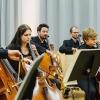 Lukas & Hanno mit Teilnehmern beim Cello-Orchester-Workshop der